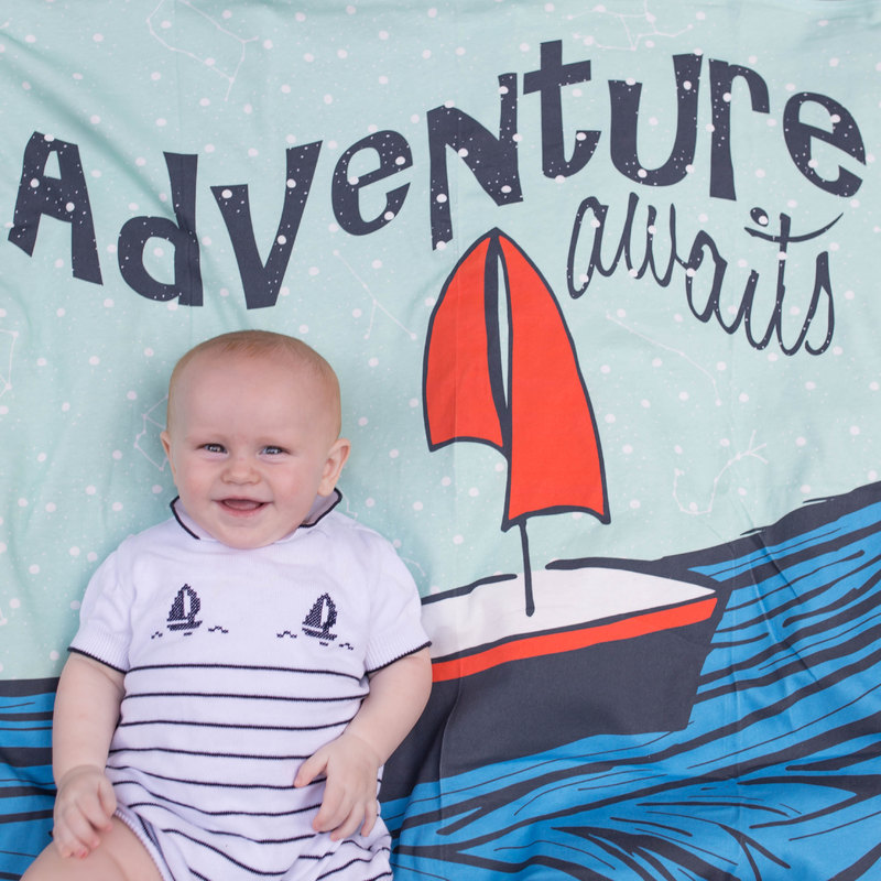 5 month old baby on adorable blanket from charlie rowan design